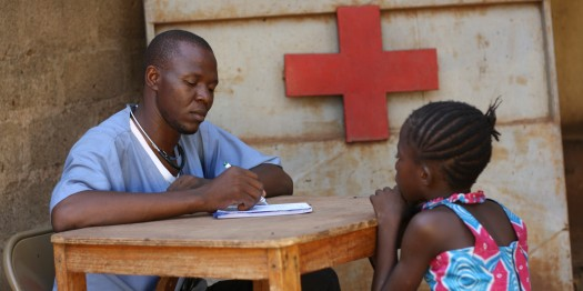 African-doctor-attending-to-a-young-female-patient